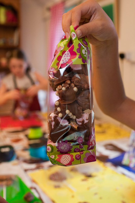 the excitement of children making a bag of chocolates