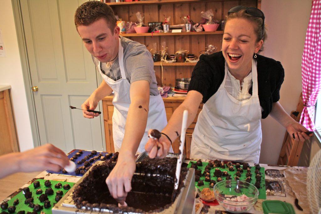 Two people making chocolates