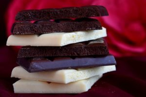 squares of white and dark chocolate in a pile