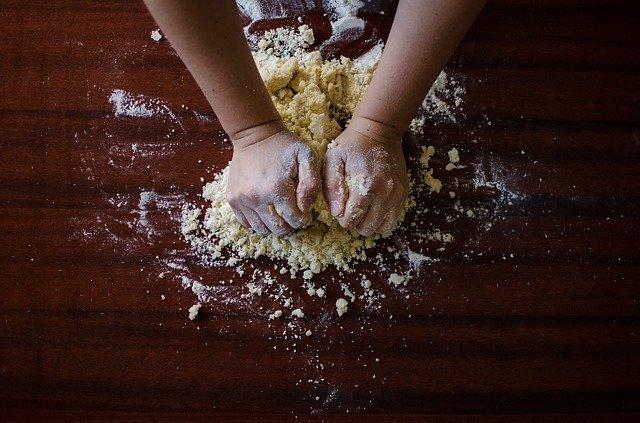 Kneading dough on a floured board