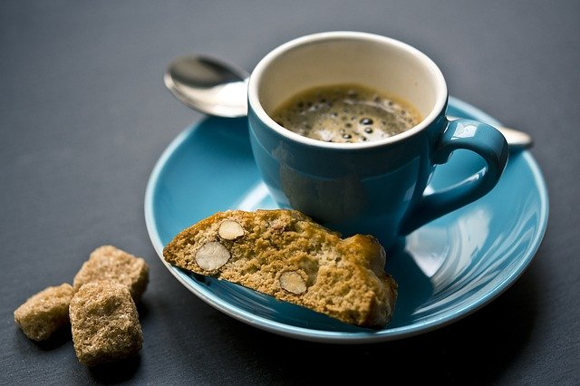 espresso coffee, biscotti and sugar cubes