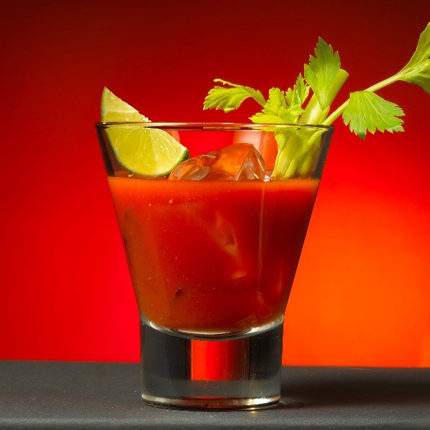 Bloody Mary cocktail with lime and celery