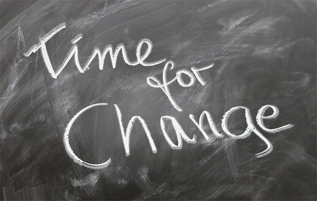 Blackboard with the words time for change written on in white chalk