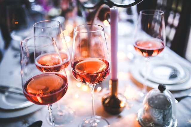 Four glasses of rose wine on a table
