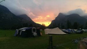 campsite in the mountains with sun setting