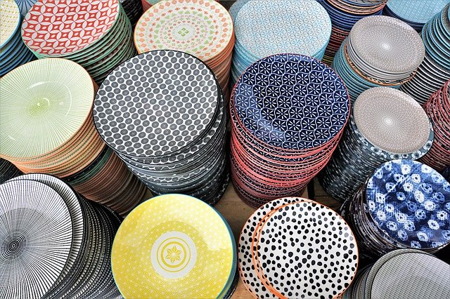 Piles of pottery small plates in different patterns