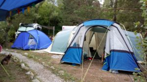 Two tents, one small, one large with awning.