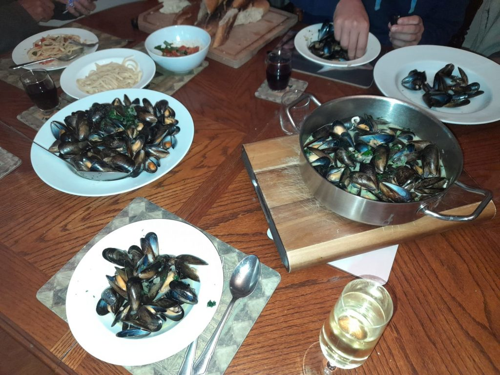 Dishes and plates of mussels on the table