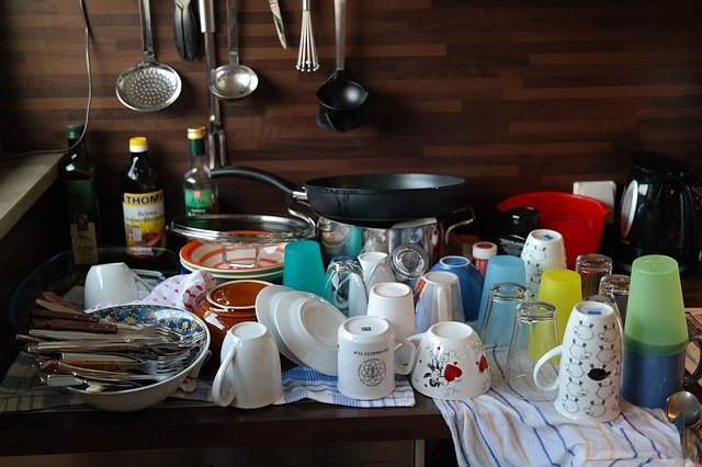 A pile of recently washed up dishes and other kitchen utensils