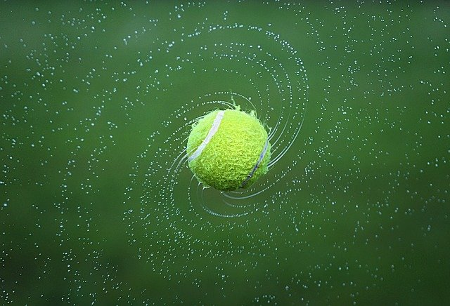 Tennis ball spinning with water