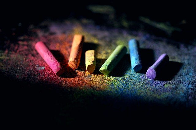 Different coloured chalks on a blackboard