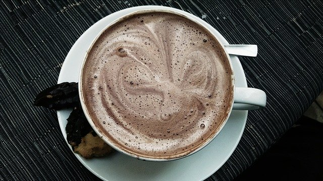 Hot chocolate drink in white cup and saucer